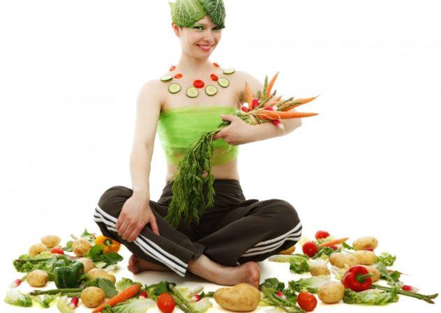 野菜をまとった女性